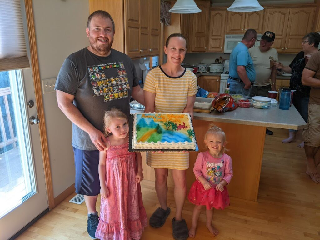 FIRE Travel Family - Dubuque - Retirement Party Picture - Brock, Becky, Kyra, Verity - Financial Independence - Retire Early