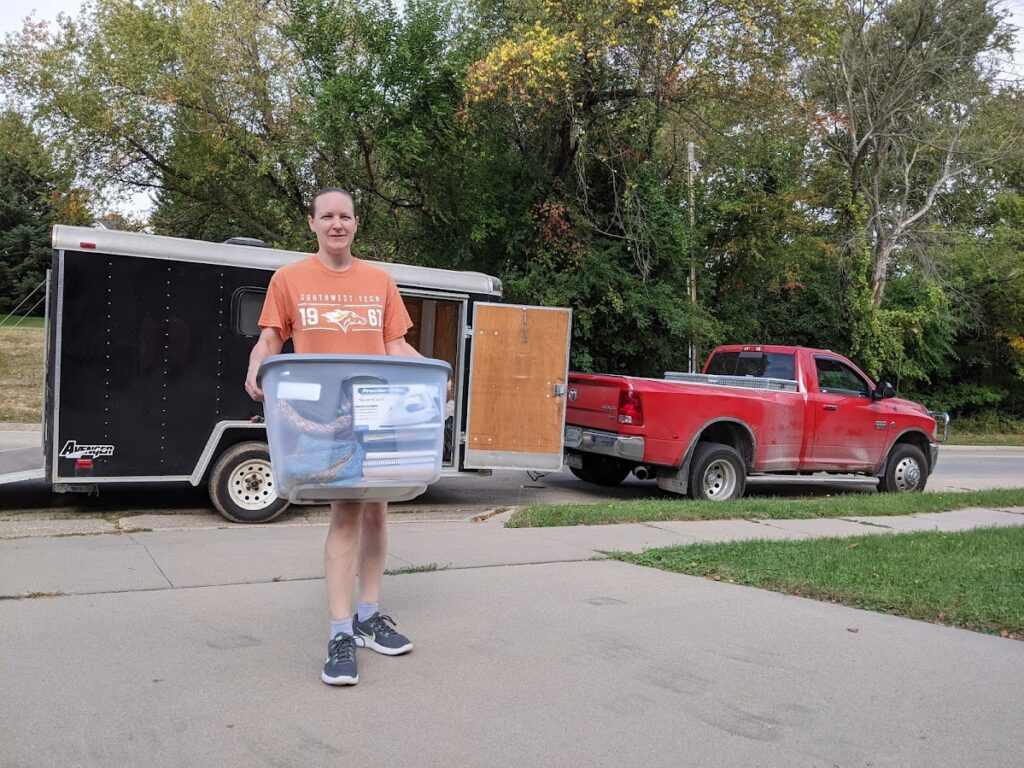 FIRE Travel Family - Dubuque - Becky Packing Trailer Picture - Brock, Becky, Kyra, Verity - Financial Independence - Retire Early