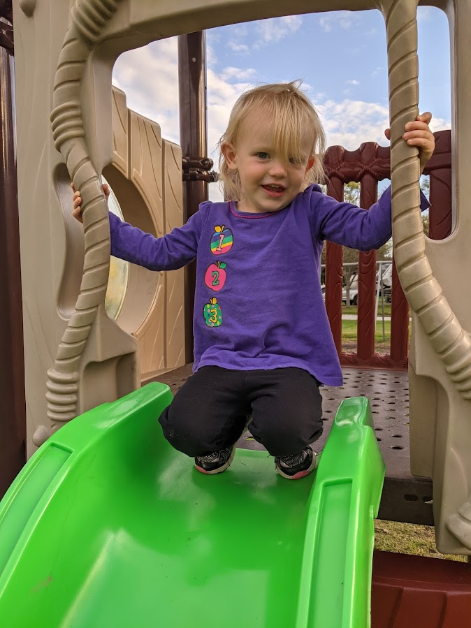 FIRE Travel Family - Ohio - Verity on Campground Slide - Financial Independence - Retire Early